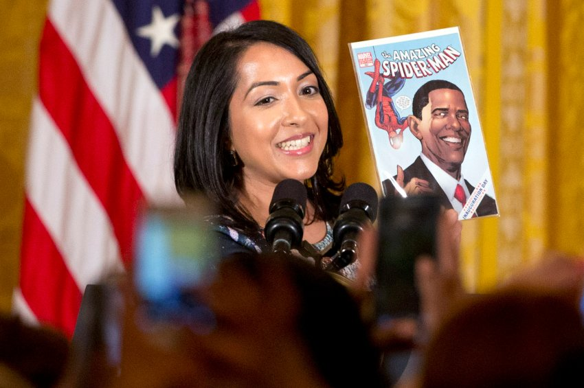 Ms. Marvel co-creator Sana Amanat holds up a Marvel comic book featuring President Barack Obama as she introduces him during a reception for WomenÃs History Month in the East Room of the White House in Washington, Wednesday, March 16, 2016. (AP Photo/Jacquelyn Martin)